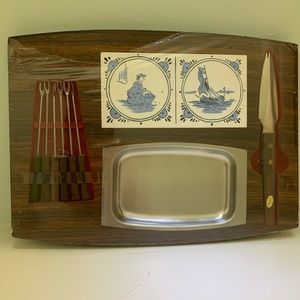 Vintage cheese tray with utensils.